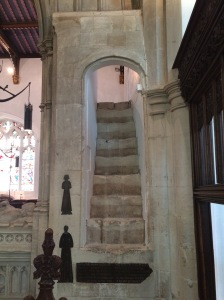 Medieval stairway reminiscent of Henry V's chapel at the Abbey with restored memorials inlaid in the wall and a glimpse of the roof.